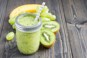 Healthy smoothie with kiwi, green grape, and banana, copy space