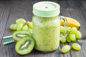 Healthy smoothie with kiwi, green grape, and banana in jar