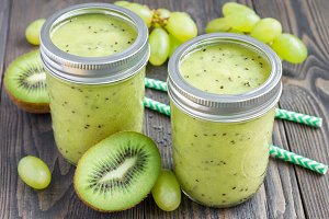 Healthy smoothie with kiwi, green grape, and banana in jars