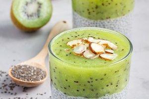 Vanilla chia pudding with kiwi, layered dessert, concrete background