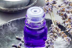 Lavender oil in a glass bottle. Vertical close-up