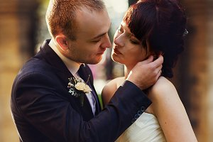 Groom leans to a bride