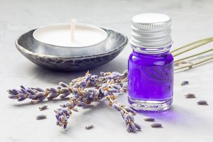 Lavender oil in a glass bottle. Horizontal close-up
