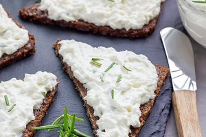 Pumpernickel bread with feta, cream cheese, rosemary, lemon, garlic dip