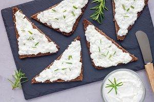 Pumpernickel bread with feta, cream cheese, rosemary, lemon, garlic dip