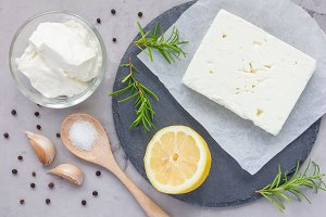 Ingredients for feta, cream cheese, rosemary, lemon and garlic dip