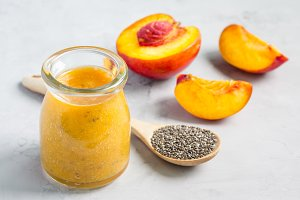 Smoothie with nectarine, orange juice, chia seeds and honey, horizontal