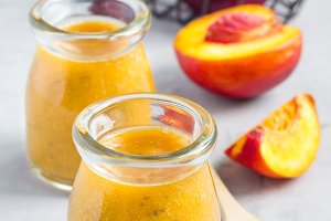Smoothie with nectarine, orange juice, chia seeds and honey, vertical