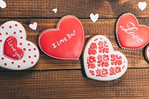 Heart-shaped biscuits for Valentine's Day. Gingerbread Valentine on wooden background. Free space for your text