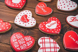 Heart-shaped biscuits for Valentine's Day. Gingerbread Valentine on wooden background
