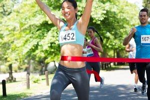 Marathon runner crossing finish line