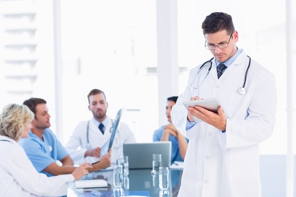 Doctor using digital tablet with co…