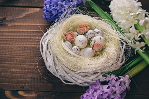 Beautiful Easter eggs with flowers hyacinths on the wooden background