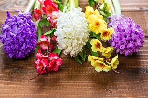 Fresh hyacinth flowers on wooden background. Beautiful idea for greeting cards for Valentine's day, March 8 and mother's day