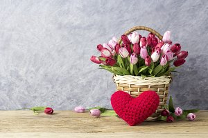 Tulip in basket with red heart