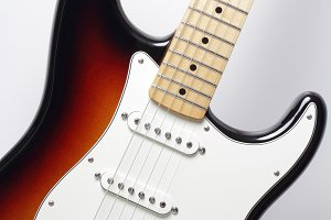 Electric guitar in sunburst colors close-up. Vertical composition
