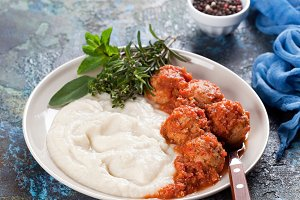 Meatballs with spicy tomato sauce and mashed cauliflower