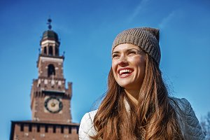 smiling tourist woman near Sforza Castle in Milan, Italy