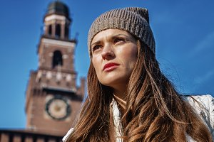 Portrait of trendy tourist woman in Milan, Italy
