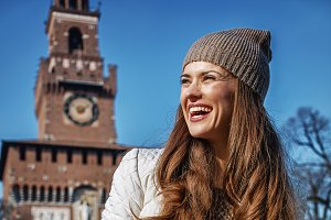 happy young tourist woman in Milan, Italy with map