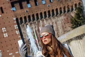 traveller woman taking selfie with smartphone in Milan, Italy