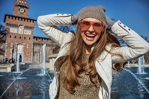 happy young traveller woman in Milan, Italy having fun time