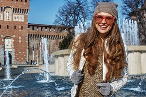 Portrait of smiling young tourist woman in Milan, Italy