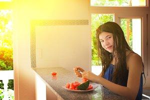 teen girl cut water melon