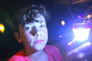 boy with flashlight on night