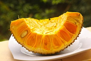 ripe jack fruit cut section on plate