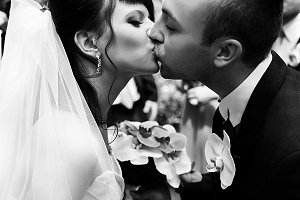 Prerfect bride and groom kiss