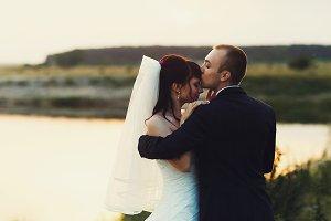 Groom kisses bride's forehead