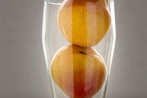 Small red pears in glass, still life concept