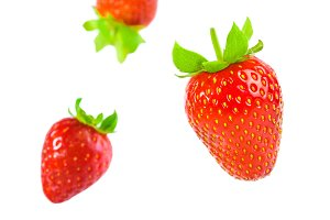 Fresh juicy red berry strawberry falling isolated on white background. Concept