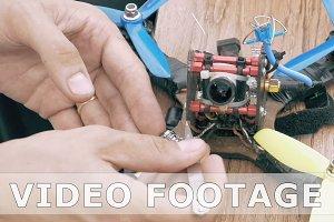 Man assembling FPV drone using tools