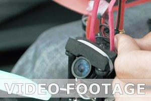 Assembling FPV drone preparing quadcopter flight