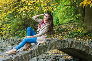 beauty girl sitting on bridge