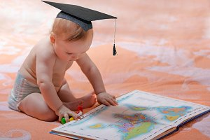 Little academic with atlas of maps