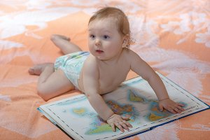 Little boy with maps