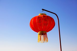 Chinese new year lantern hanging on the pole over blue sky