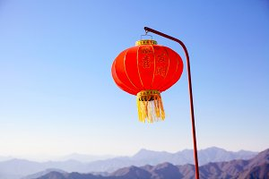 Chinese new year lantern hanging on the pole over blue sky and mountain