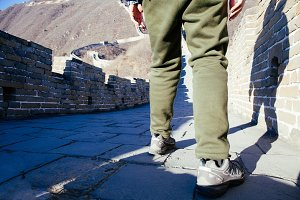 Closeup of Traveler's Feet walking in Great wall of China - Travel in China, Asia concept