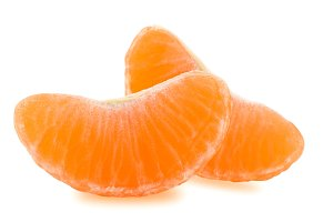 Two slices of tangerine isolated on white background