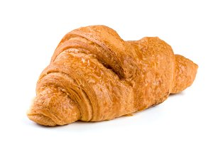 one croissant isolated over a white background closeup