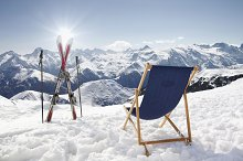 Cross ski and sun-lounger at alps