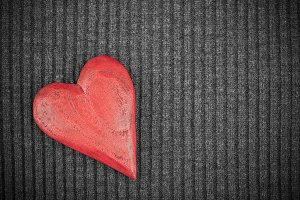 Wooden Heart on Knitted Background