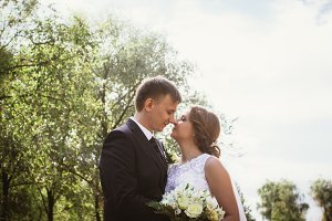 portrait of a couple bride and groom on  park background