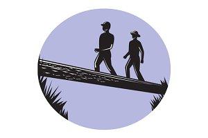 Hikers Crossing Single Log Bridge