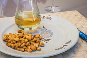 roasted corn and glass of whiskey