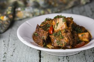 Meat ribs with tomato sauce